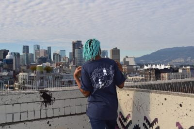 Navy Autonomy and Liberation tee on black model with turquoise hair - Pic #3