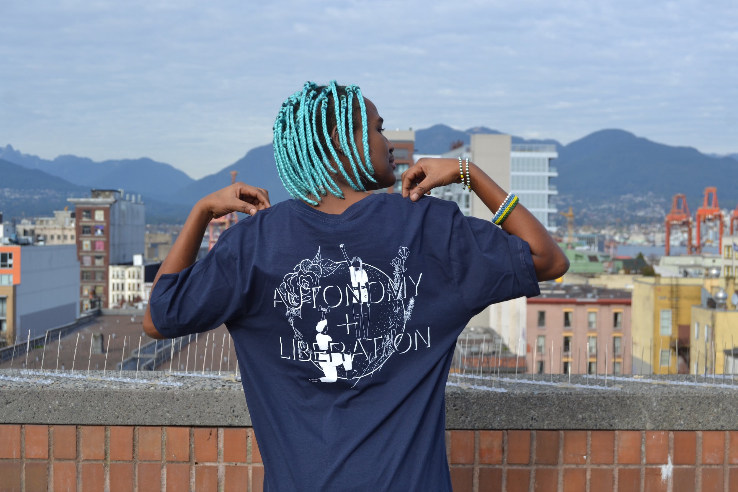 Navy Autonomy and Liberation tee on black model with turquoise hair